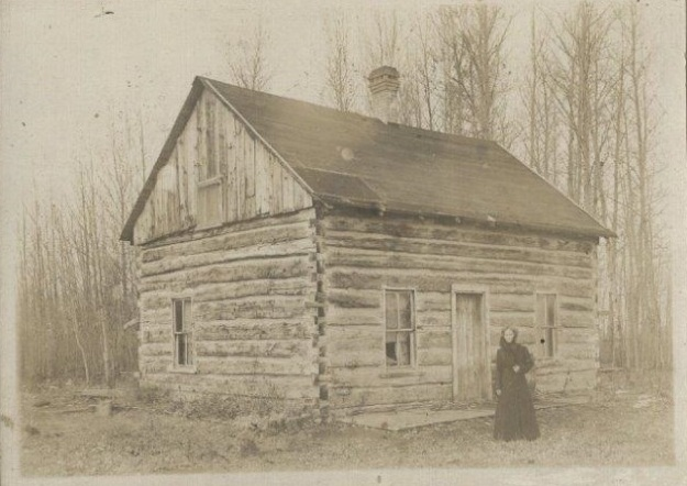 Catherine Gillespie  in front of cabin