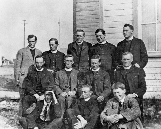 Image No: NA-1687-43 Title: Anglican clergymen in southern Alberta. Date: [ca. 1914] Remarks: Back Row: Extreme left: Canon S.H. Middleton. Front Row: (hand to eyes), Mr. Cripps. [Used in conjunction with script of talk on Anglican missions in Western Canada.